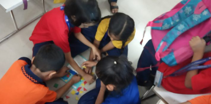 Grade 1 students engrossed in the class learning pattern and sequencing